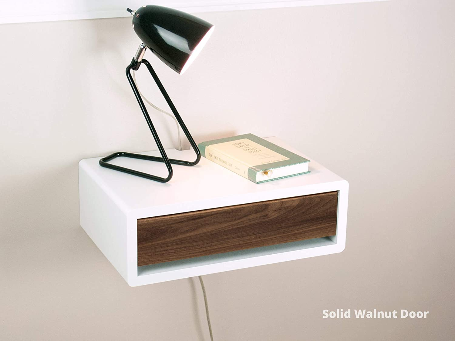 hanging wall drawer with a lamp and book