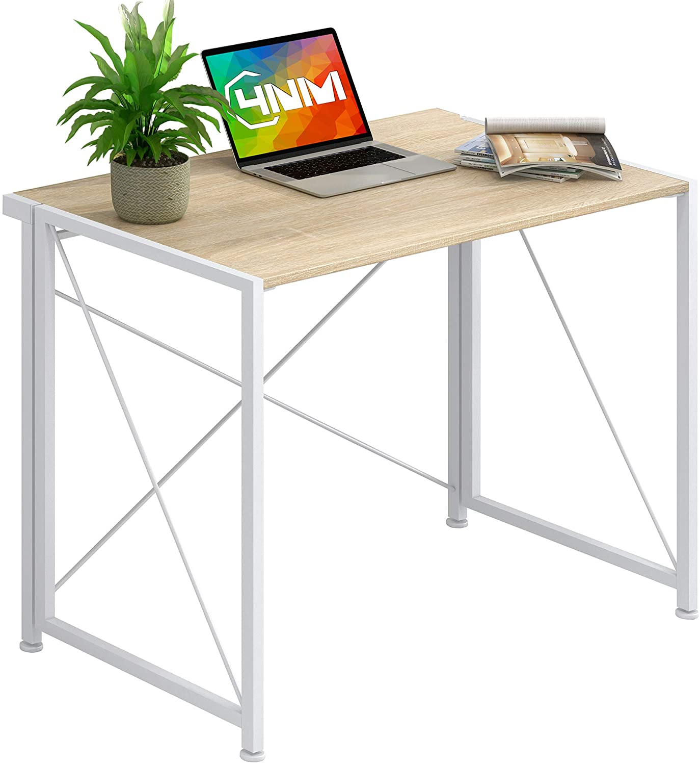 foldable office table with a laptop and a plant