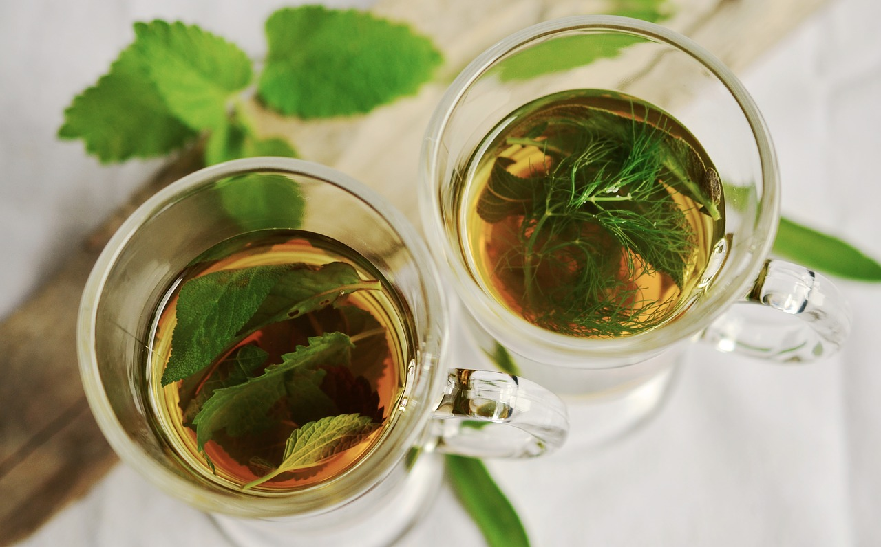 overview of tea with sage leaves inside as herbs