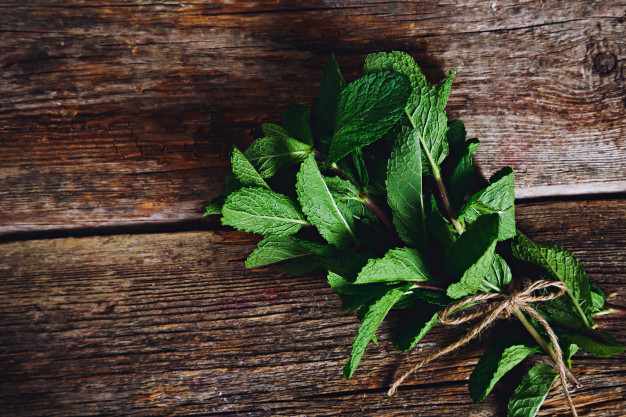 mint leaves on a wooden table