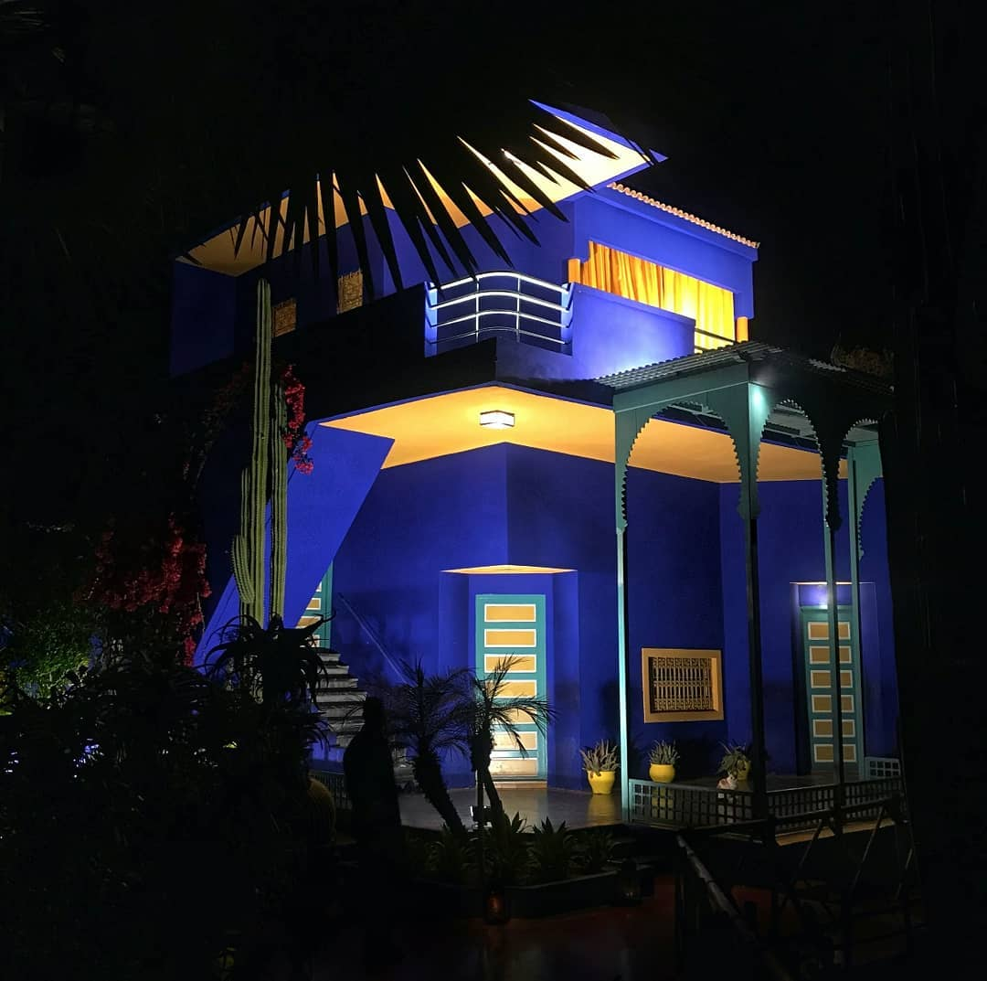 a night time photography shot of Jardin Majorelle Morocco building