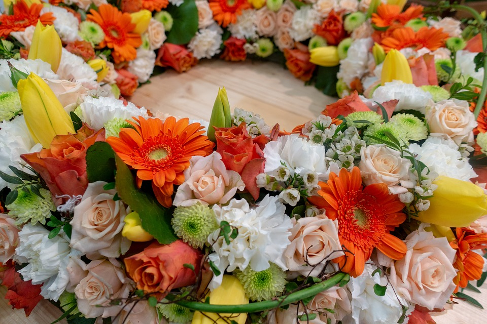 colorful sunflowers and roses in a wreath arrangement